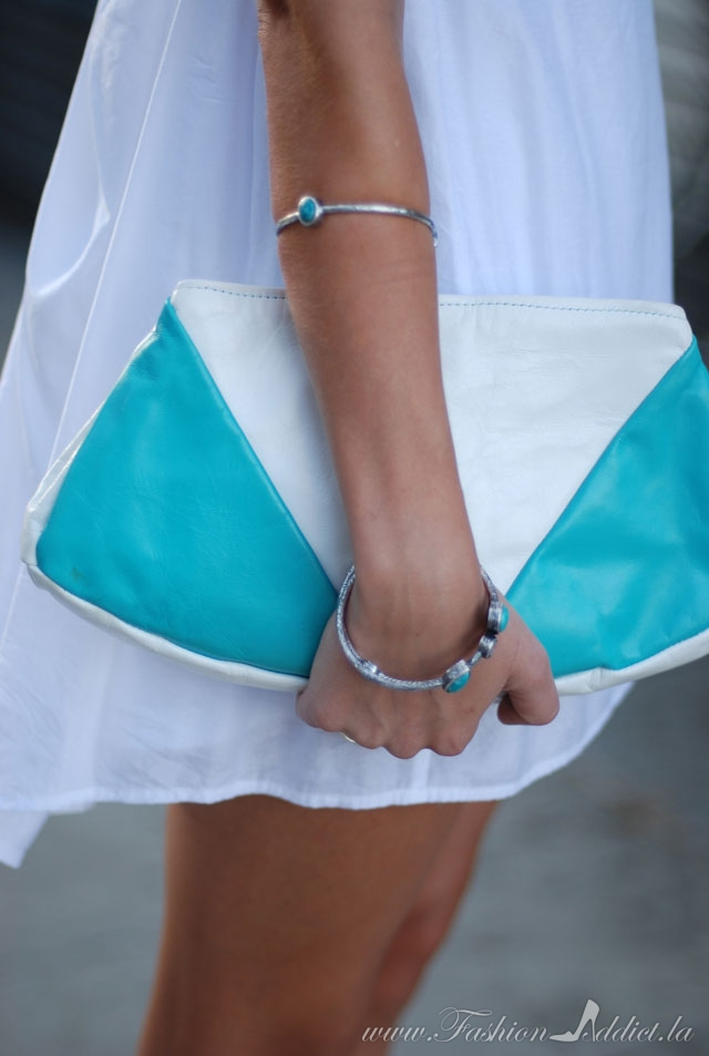 Turquoise-and white clutch