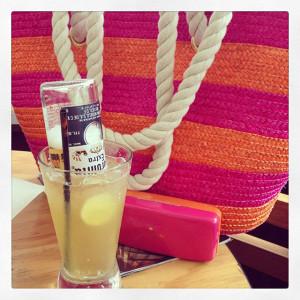 pink and orange straw bag
